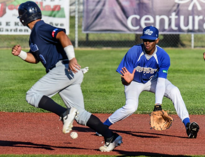 Garden City Wind shortstop Manuel Blanco readies to scoop up a grounder as Salina Stockade's Caleb Rosario avoids getting hit by the ball Thursday at Clint Lightner Field. Blanco threw to third base to get Rosario out. The Wind even the series to 1-1 with a 25-2 win.