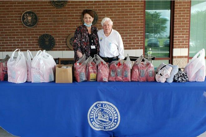 Delphin Russelburg with Sonya Hebert, Reserve SE Veterans Home activity director.