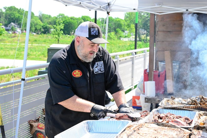 Owner of Great White Smoke, Dave White, prepares brisket for hungry customers during the first Food Truck Friday of 2021 at Switchyard Park.