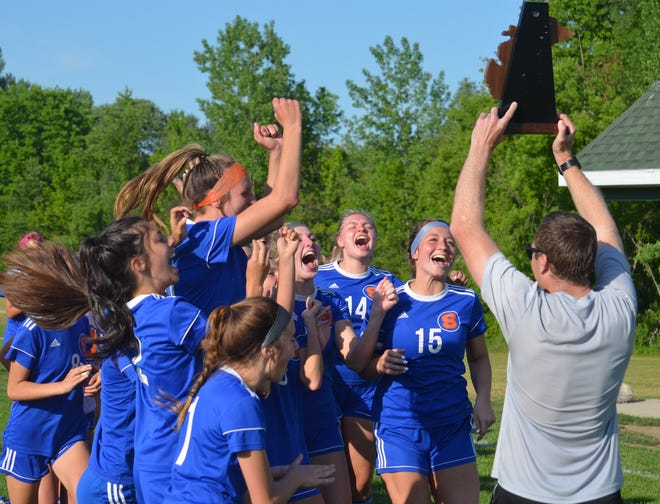 The Saugatuck girls soccer team celebrates winning its first district championship on Thursday in Hartford.