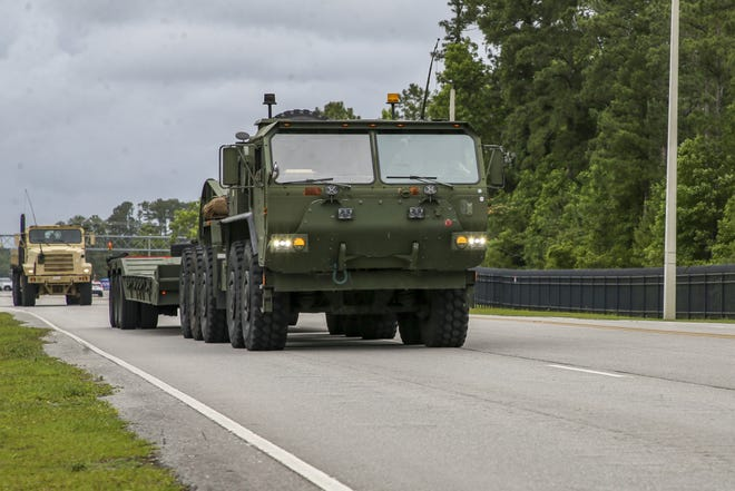 U.S. Marines drive onto Camp Lejeune, North Carolina, on June 3, 2021. Marines with 2nd Transportation Battalion, Combat Logistics Regiment 2, 2nd Marine Logistics Group conducted a convoy across the United States starting in Camp Lejeune, North Carolina, in one of the longest convoys in recent Marine Corps history. Marines on the convoy experimented with long-range communications, as far away as Marine Corps Air Ground Combat Center Twentynine Palms, California, the halfway point on the route.