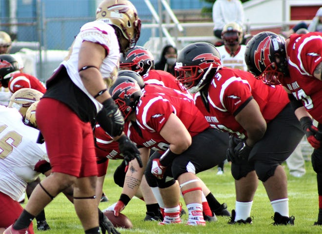 Monroe grad Larry Williams (73) lines up at left guard for the Southeast Michigan Red Storm during the team's season opener against the Detroit Seminoles on May 15, 2021.