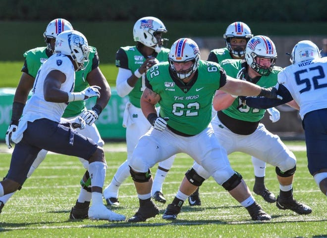 Marshall grad transfer offensive guard Cain Madden, a 2020 All-American, has committed to joining Notre Dame  for the 2021 season.