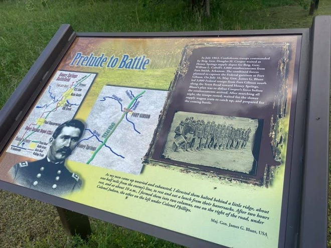 A sign along a trail at the Honey Springs Battlefield provide historical information for visitors. In June and July, students from the University of Science and Arts of Oklahoma will provide guided tours along six trails at the battlefield.
