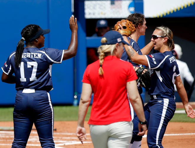 USSSA Pride's Shay Knighten high fives Shelby Pendley during a softball game between USA softball and USSSA Pride  at USA Softball Hall of Fame Stadium in Oklahoma City, Friday, June 4, 2021.