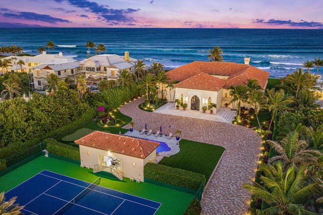 A cabana building links the tennis court to the swimming pool at 1160 S. Ocean Blvd. in Manalapan. The sea-to-lake estate just sold for a recorded $28 million.