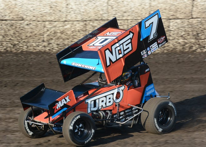 Tyler Courtney (7) turned back a late race challenge from Rico Abreu and Bill Balog in winning the All Star Circuit of Champions Sprin Car feature.