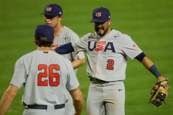United States second baseman Eddy Alvarez (2) celebrates with teammates during a victory against Nicaragua in the Olympic baseball qualifying tournament on May 31.