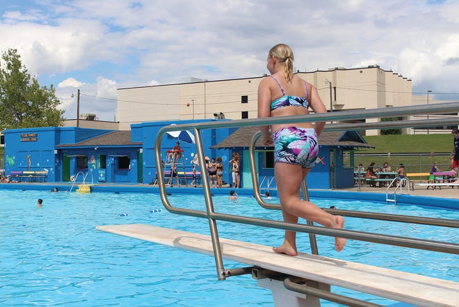 Kaleigh Holmes heads for open water off the diving board Wednesday at the Ellis Kinney Swimming Pool in Pratt.