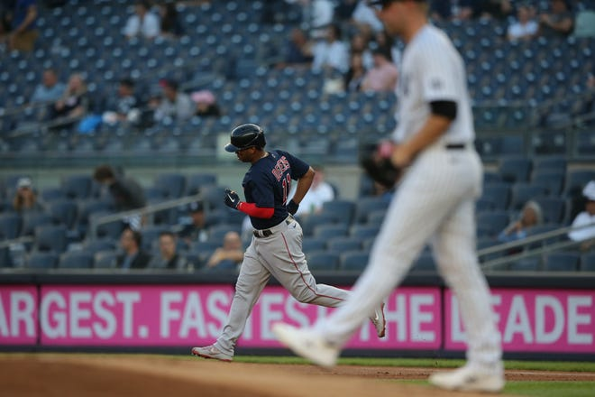 Red Sox third baseman Rafael Devers, left, rounds the bases after hitting a three-run home run against  Yankees starter Michael King, the former Bishop Hendricken star, during the first inning of Friday night's game in the Bronx.
