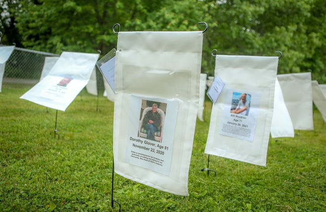 Artist Nancy Rafi and other volunteers organized the white flag display to commemorate the 81 North Kingstown residents who died of COVID-19.