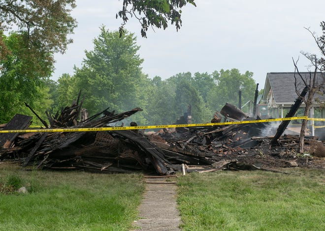 The remains of a Palmyra bed and breakfast house fire occurred in the early hours Friday June 4. Smoke continues to rise through the rubble.
