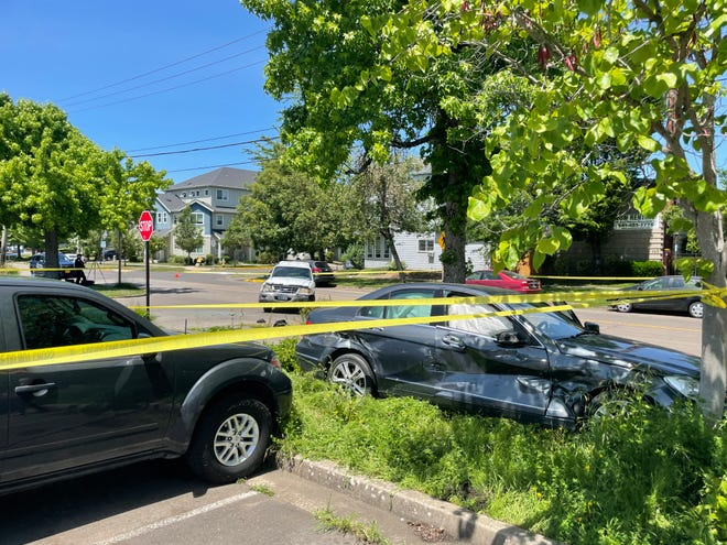 Two vehicles involved in a pedestrian-vehicle crash on 19th Avenue at South Eugene High School on Friday, June 4, 2021. The stop sign is at the  school's east parking lot driveway on 19th.