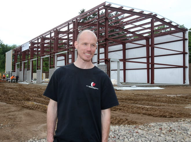 Justin Smock, owner of All Makes & Models Auto Repair, talks Friday afternoon about his new facility that's under construction in Jackson Township. The business has plans to move into a new home in late August or early September at 5257 Fulton Drive NW. The new facility, just west of Fishers Foods, is being built by Scheetz Building Corp.
