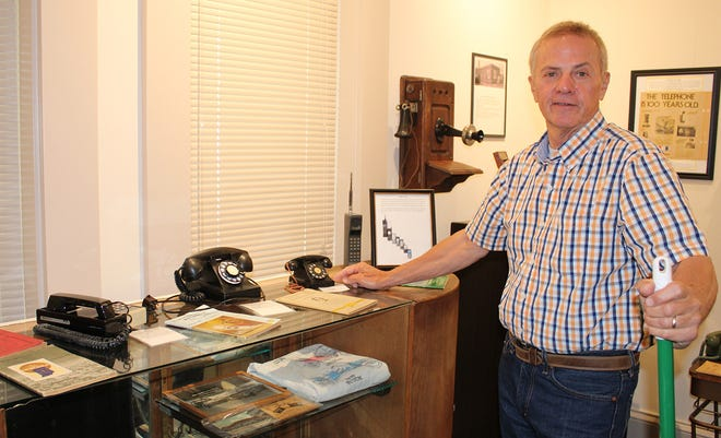 Local historian Darrell French showcases some old telephones that sit on display in the future Morgan County History Museum.