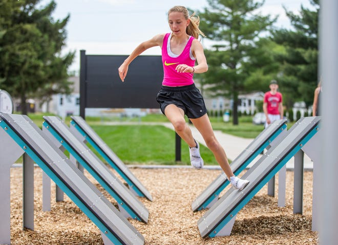 Jillian Waelbroeck, 16, tests her abilities on an obstacle course at Heroes Park on Friday in Mishawaka. The renovation of Hums Park includes an extreme fitness obstacle course and many other amenities that appeal to teens.