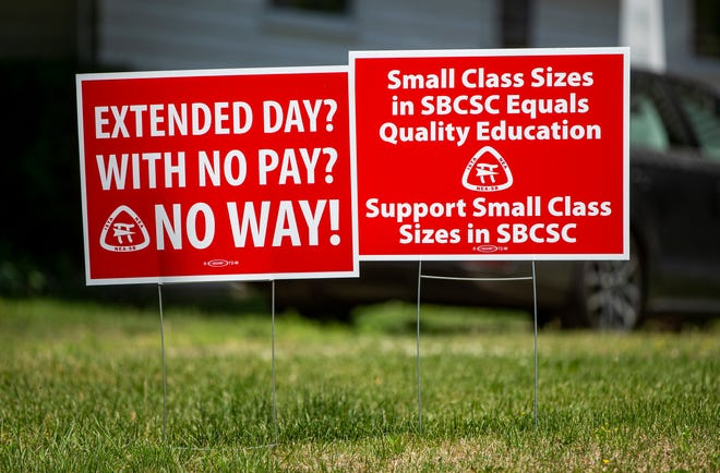 Signs in front of a home on Portage Avenue are directed at South Bend Community School Corp.'s administration on Friday in South Bend.