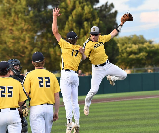 Stephenville third baseman Charlie Hughes (7), right, and Cade Wright (17) celebrate after Hughes' inning-ending diving catch during Thursday's Game 2 of the Region I-4A final series against Argyle at ACU's Crutcher Scott Field on Thursday. The Jackets won 6-1 to earn the first state berth in program history.
