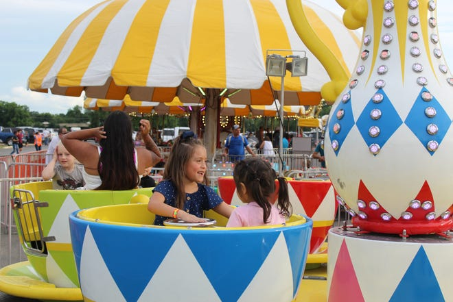 Children of all ages --- and even some adults --- enjoyed the rides of Carnival Americana during Thursday evening's opening of the 2021 Moo-La Fest in Stephenville City Park.