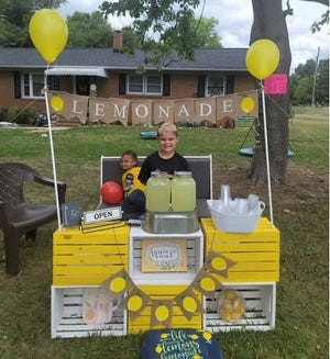 Izaak Degree opened a lemonade stand this week to celebrate his birthday and make some cash. His little brother, Ian, joined in.