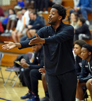 Markus Black coaches Booker High against IMG Academy National. on Jan. 23, 2020. Black left the Tornadoes to join the staff at the University of Arkansas.
