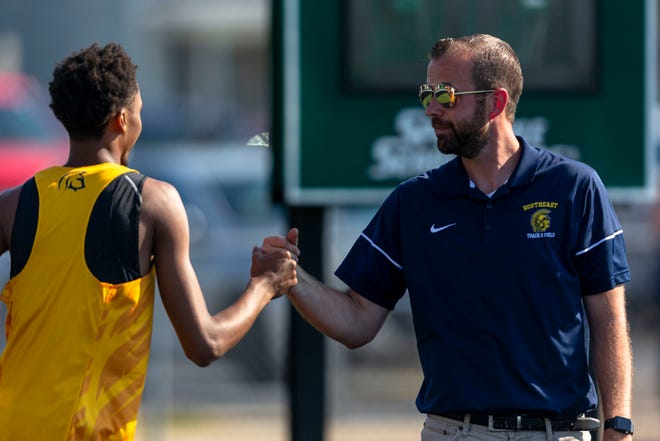 Southeast Track and Field Coach Chris Hood congratulates James Dent after setting a PR clearing 5-10.00 during the Boys Central State Eight Track & Field Meet at Memorial Stadium in Springfield, Ill., Thursday, June 3, 2021. [Justin L. Fowler/The State Journal-Register]
