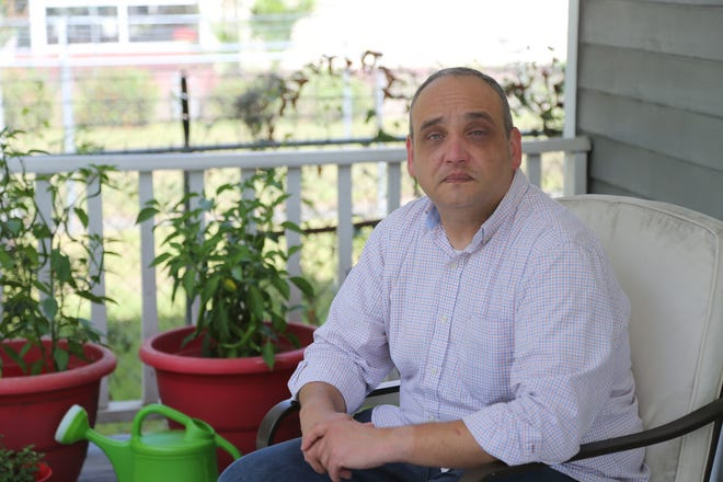 Former Effingham County High School teacher Clint Tawes sits on the porch of his Savannah home.