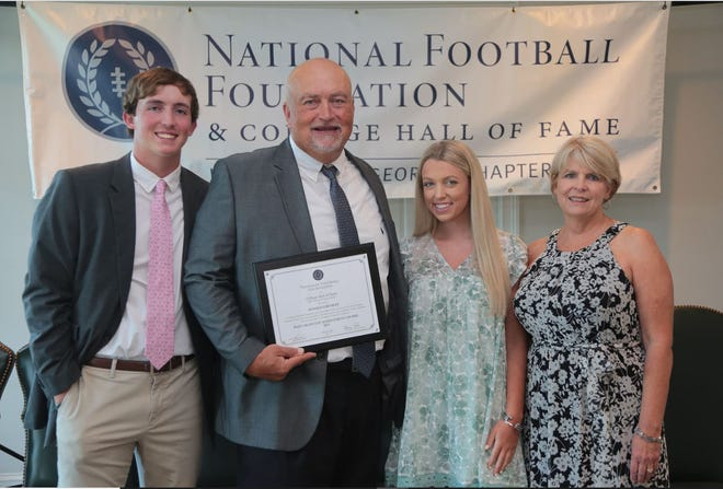 South Effinhgam High School defensive coordinator and former Savannah Christian head coach and Georgia football player Donald Chumley was honored when the National Football Foundation's University of Georgia chapter held its banquet May 24 at the Athens Country Club. Chumley and his wife, Angela, have two children, Anna and Noah. Anna is attending Emory Law School and Noah is a punter on the Georgia football team.