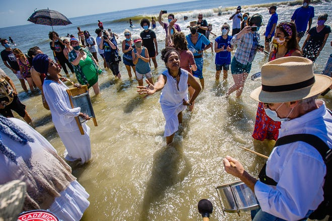 Participants dance in the ocean as they celebrate during the annual Juneteeth Wade In on June 19, 2020, on Tybee Island. Juneteeth is a celebration of the day Union Soldiers reached Galveston, Texas, on June 19, 1865, with the news that the war had ended and enslaved people were free.