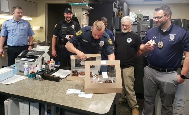 From left, Austin Koontz, Dalton Kuffel, Eric Hamilton, Salvation Army director Eddie Toliver, SA volunteer Mickey Hand and Andrew Kingdon inspect donuts delivered to the Kewanee police and fire departments as part of National Donut Day.