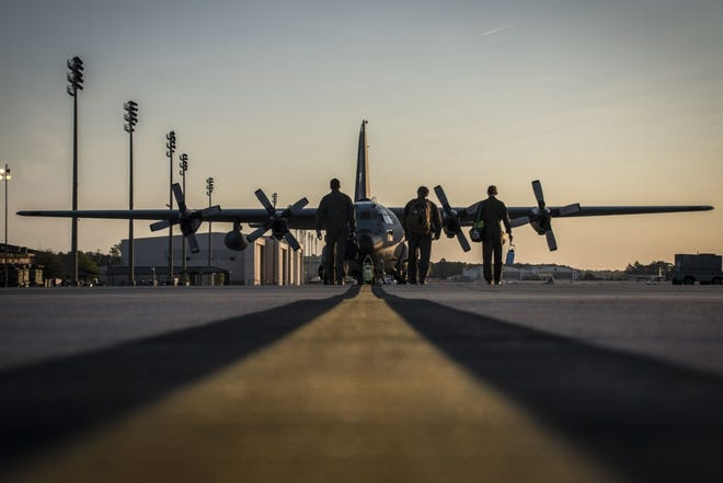 Loadmasters from the 164th Airlift Squadron prepare to begin pre-flight inspections April 11, 2019, at Pope Army Airfield. Units that use the airfield for training and missions will temporarily use regional airports, as the airfield undergoes a construction and lighting project.