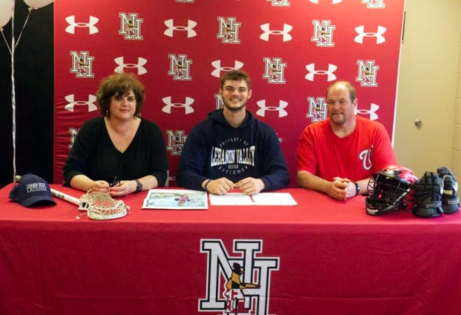 Garrett Evans signs his letter of commitment with Lebanon Valley College.