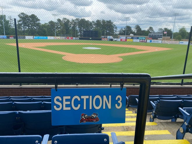 New signs branded with Sock Puppets logos identify seating sections at Burlington Athletic Stadium.