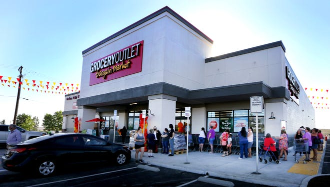 Customers lined up around the Grocery Outlet just before the 8 a.m. opening.