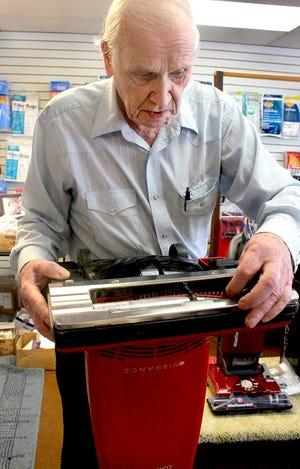 "Wolfgang ""Johnny West"" Heyn checks the brush roller on a vacuum he is repairing at The Vac Shoppe, 3307 N. Elizabeth."