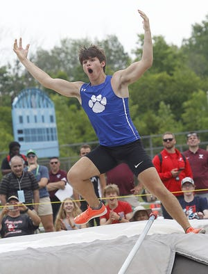Hilliard Davidson's Jack De Francesco celebrates after clearing 16 feet, 6 inches in the pole vault during the Division I state meet June 4 at Hilliard Darby. He finished second behind Cincinnati Turpin's Paul Signorelli (16-10).