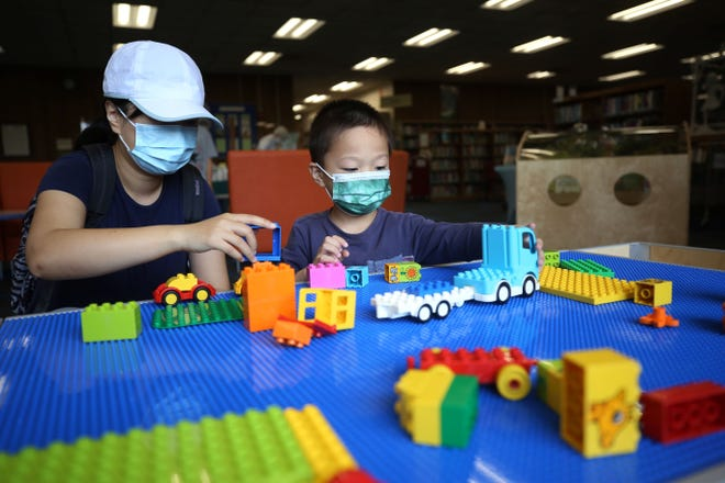 Betty Zhang and son Shaun Diao, 3, play June 1 in the new early-learning play area at the Upper Arlington Library main branch, 2800 Tremont Road.