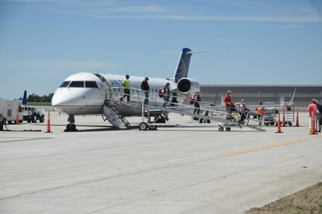 Passengers get off a SkyWest flight at Watertown Regional Airport Friday afternoon. The air carrier was not selected to stay on as the Essential Air Service provider for the Watertown and Pierre airports.