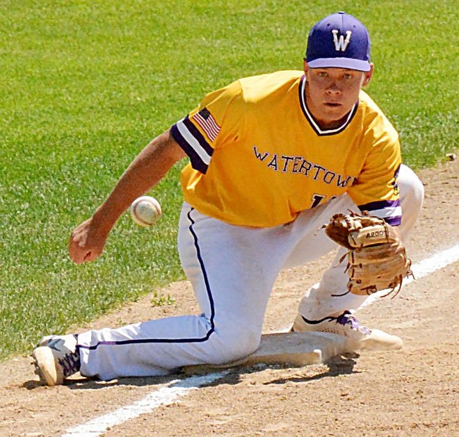 Watertown Post 17 third baseman Jerod Cyrus fields a throw from catcher Braxton Lacher on a stolen-base attempt during their American Legion Baseball doubleheader Thursday against Sioux Falls West at Watertown Stadium.