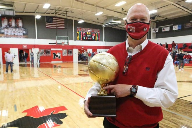Former Maypearl head girls' basketball coach Greg Kudrna holds the championship trophy after the Lady Panthers won the 9-3A championship in February. Kudrna has announced his retirement from coaching.