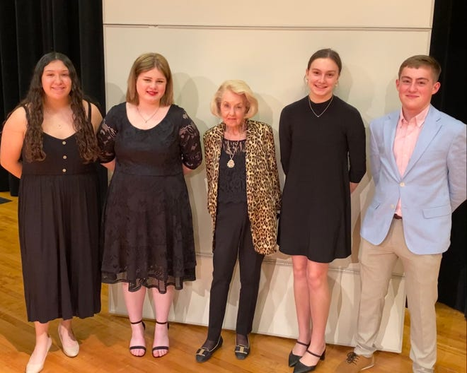Waxahachie Symphony Association award chair Winnie O'Donnell (center) poses with honorees (from left) Evelyn Hernandez, Brogan Sloan, Lilyanna Armstrong and Logan Boyd.