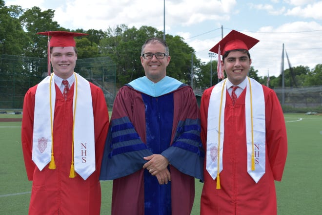 Catholic Memorial High School's 61st commencement took place May 27 on the grounds of the football field. Pictured are President Peter Folan; Matthew D. Floyd, salutatorian; and Giuseppe G. Presti, valedictorian.