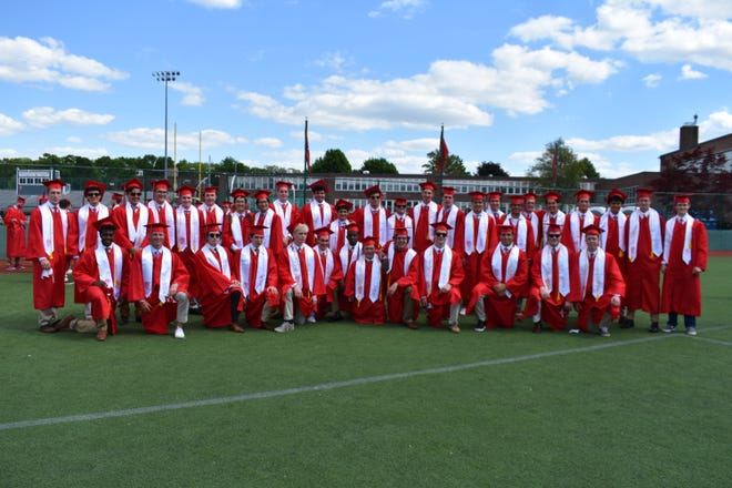 Catholic Memorial High School's 61st commencement took place May 27 on the grounds of the football field. Members of the National Honor Society get together for a group photo.