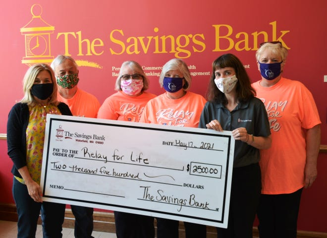 Representatives of The Savings Bank and its Relay for Life team, the TSB Lifesavers, presented the donation to Relay for Life representatives. Raichelle Kallery, left, executive VP, senior retail banking officer, and Amy Walsh, second from right, floating branch manager, presented the donation to Relay for Life representatives, from left, Bill Brown, Claire Brown, Deborah Ameele and Elaine Silva.