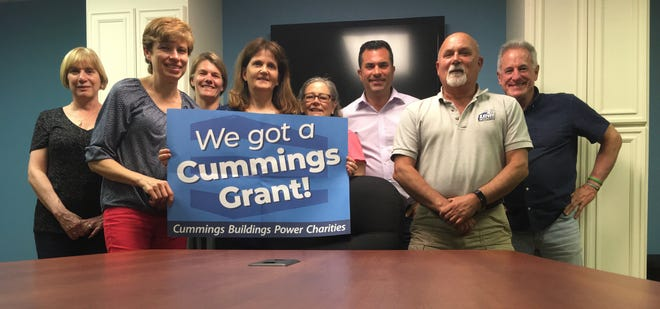 Wakefield Food Pantry's board of directors celebrated the grant from the Cummings Foundation. From left, Doreen McGowan, Rose Finn, Catherine Dhinga, Executive Director Maureen Miller, Melissa Lowry, John Zaya, Tom Jenkins and Mike Boudreau.