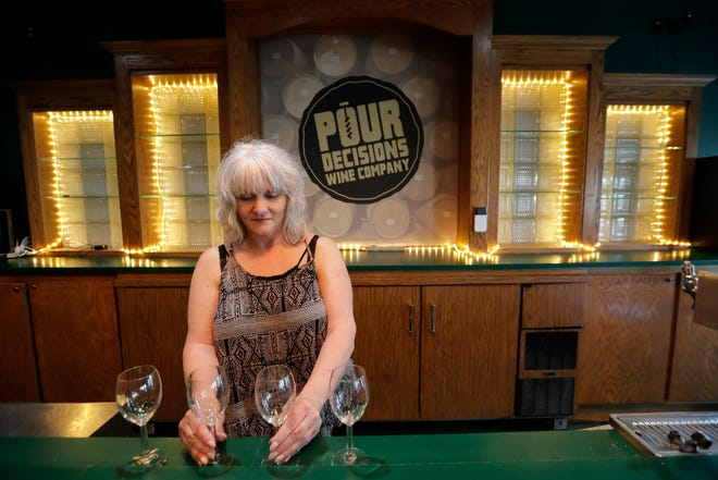 Co-owner Lisa Reissmann prepares the bar area for the new Pour Decisions Wine Company located at W7003 Parkview Drive Friday, June 4, 2021, in Greenville, Wis. Lisa owns the business with her husband Troy Reissmann.Dan Powers/USA TODAY NETWORK-Wisconsin