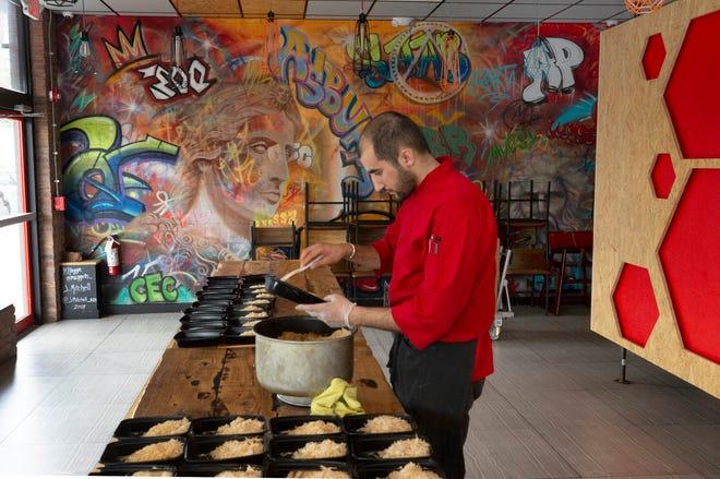 Chef Sami Saab prepares lamb lamb and chicken at his Asbury Park restaurant, Sami's Mediterranean Street Food.