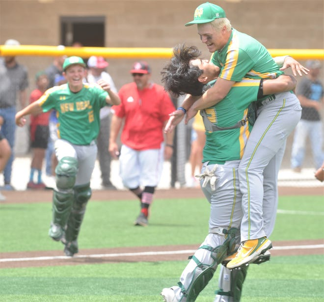 New Deal catcher Noah Rodriguez hugs pitcher Kyler Reed, right, after Reed retired all three batters he faced in the seventh inning. The Lions beat Anson 10-2 in the third and decisive game of the Region I-2A finals series Friday in Seminole.
