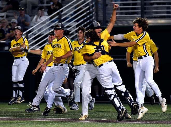 Members of the Stephenville High School Yellow Jackets celebrate their win during Thursday's Region I-4A final game against Argyle at Abilene Christian University.