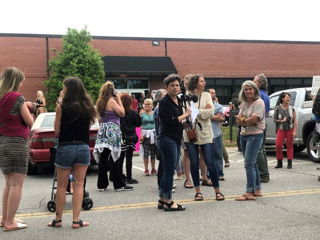 About 40 protestors gathered outside of the board of education building during the June 3 meeting to protest the district's mask mandate and voice approval of House Bill 324.